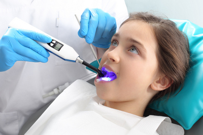 Child receiving dental sealants from DeWire Dental in Hellertown, PA